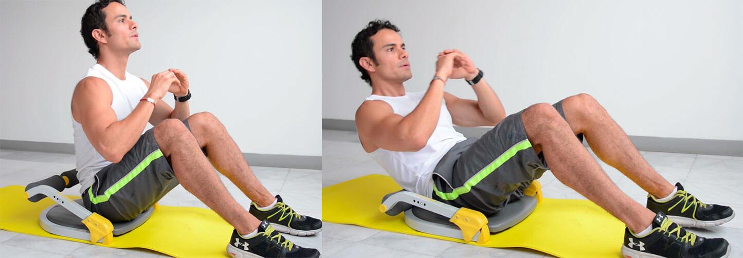 Daniel Cortés realizando abdominales con el aparato de ejercicio Ab Tomic en el nivel 3 de resistencia.