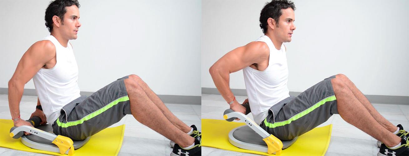 Daniel Cortés haciendo fondos con el aparato de ejercicio Ab Tomic en el nivel 2 de resistencia.